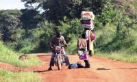 african fabric hawker enroute to kabalega lodge.jpg